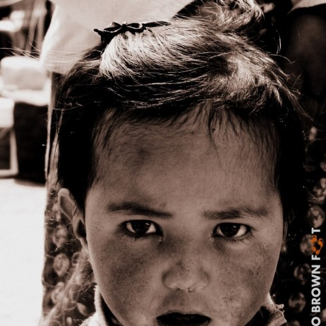 At a tea-stall in Pang, India, this cute little girl couldn't help but stare.