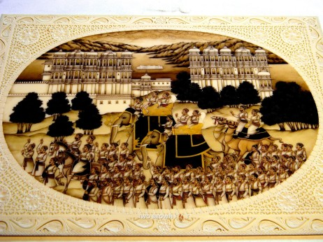 A brilliant rendition of a battle scene - painted on camel bone.