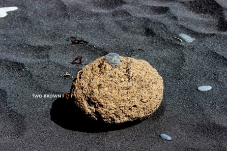 A stone on the black sandy beach - Vik