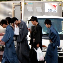 A group of young Japanese boys cross the road at Niomon - dori.